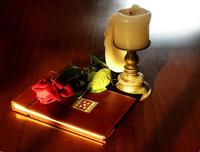 789px-Book-rose-and-candle-on-teak