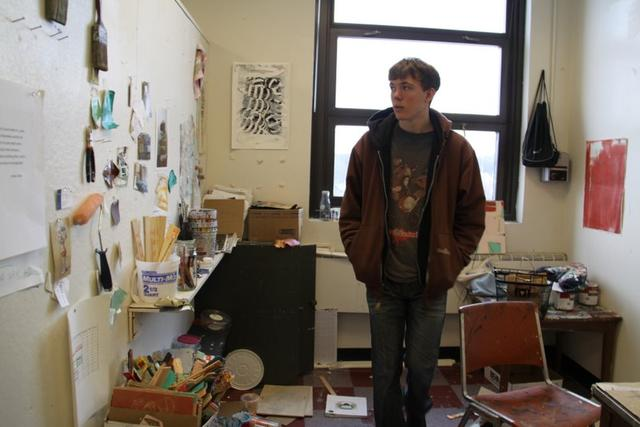 Rob Mostrom '12 taking a look around the BU undergraduate painting studios.