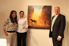 Christie with parents and most recent Brandeis painting